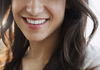 Close up of Hispanic womanÕs smile