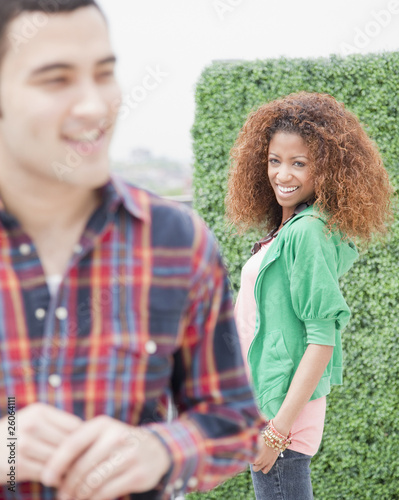 Woman smiling at passing man