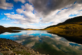 Beautiful wide view of welsh mountain range with blue lake and s poster