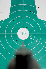 Hand gun aim straight at target