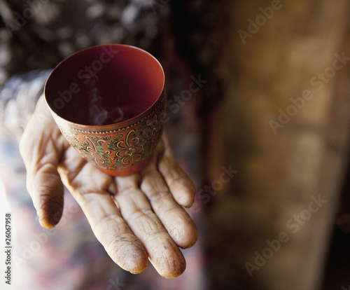 Hand holding decorative cup