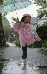 Hispanic girl playing in rain