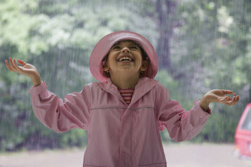 Hispanic girl standing in rain