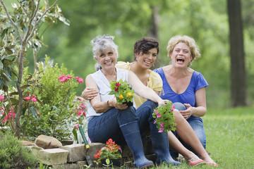Multi-generation Hispanic women in garden