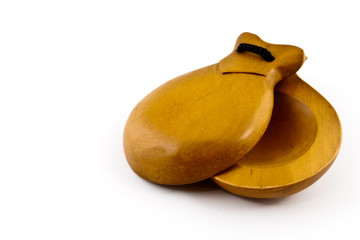 Castanets on white background