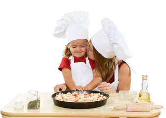 Woman and little girl making pizza