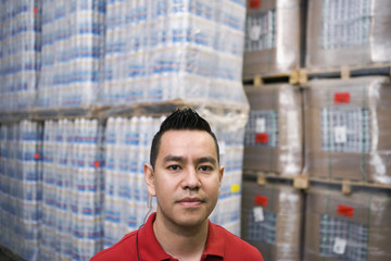 Serious Hispanic man in warehouse