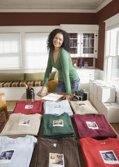 Mixed race woman with t-shirt home business
