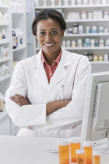 Smiling African pharmacist with arms crossed