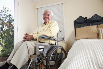Elderly Hispanic man in wheelchair