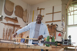 African carpenter in workshop