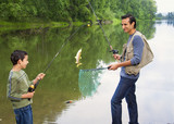 Hispanic father and son fishing