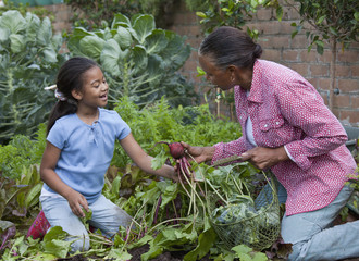 African grandmother and granddaughter in garden