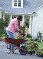 African grandmother and granddaughter gardening