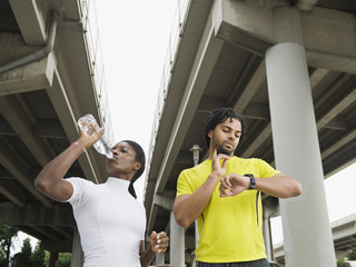 Runners taking a break under freeway overpass