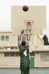 African basketball player shooting ball