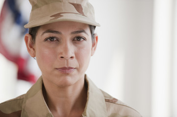 Hispanic woman in army uniform