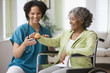 African home nurse helping woman in wheelchair with hand weight