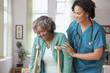 African home nurse helping woman on crutches
