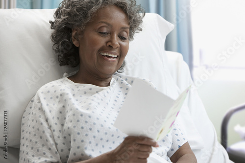 African hospital patient reading greeting card
