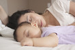 Chinese mother and baby sleeping
