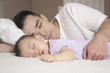 Chinese father and baby sleeping