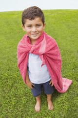 Hispanic boy wearing towel cape