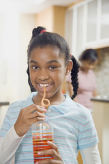 African girl drinking from curly straw