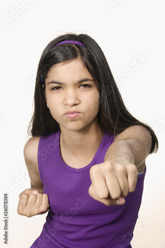 Hispanic girl in fighting stance