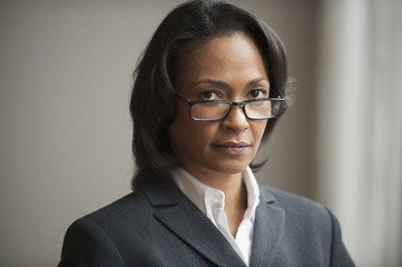 Mixed race businesswoman in eyeglasses