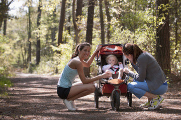 Women and baby on nature trail