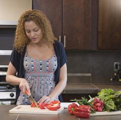 African woman preparing healthy meal