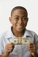 African boy holding twenty dollar bill