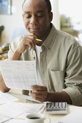 African man paying bills