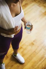 Hispanic woman holding water bottle
