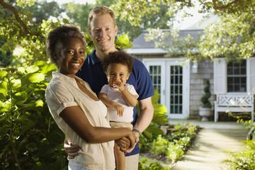 Multi-ethnic family smiling in garden
