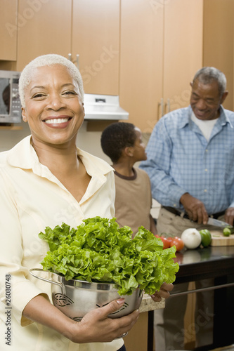 African woman preparing salad