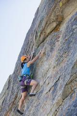 Japanese woman rock climbing