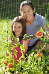 Japanese mother and daughter gardening
