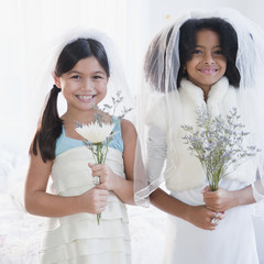 Girls dressing up in wedding dress