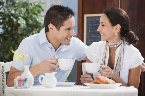 Hispanic couple having breakfast in cafe