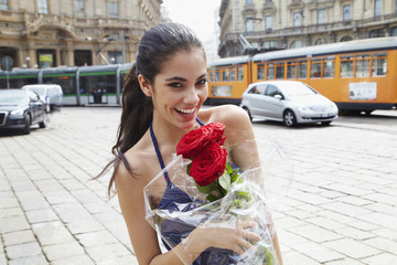 Brazilian woman holding red roses
