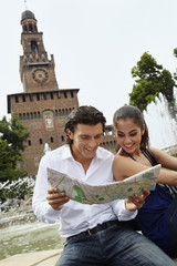 Couple sightseeing and looking at map