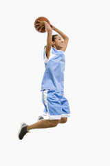 Mixed race woman playing basketball