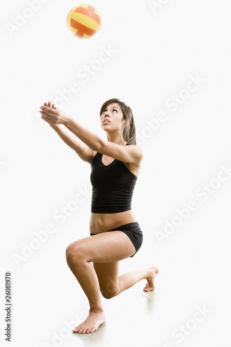 Hispanic woman playing volleyball