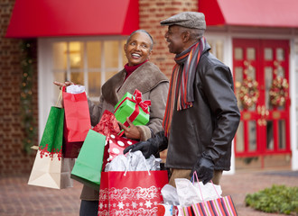 Black couple shopping at Christmas