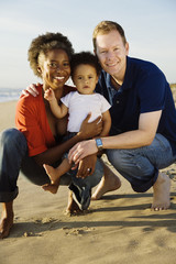 Multi-ethnic family enjoying beach