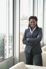 Black businesswoman standing by window