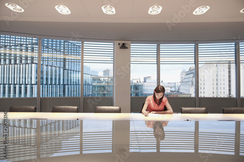 Chinese businesswoman working in conference room