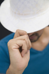 Hispanic man in white fedora hat